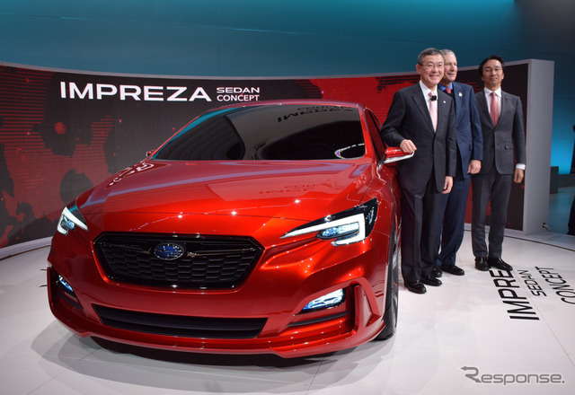 Subaru Impreza Sedan Concept and president Yasuyuki Yoshinaga at 2015 Los Angeles Auto Show