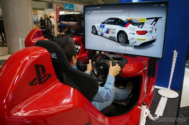 Playing the pre-relase demo of Grand Turismo 6 at the 2013 Tokyo Motor Show