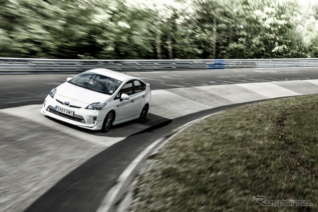 The Toyota Prius PHV driving down Nürburgring's north course