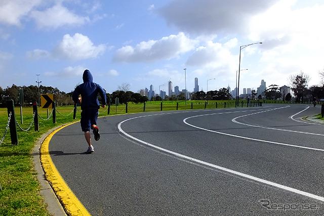 Tear one corner in F1 drivers feel 2 corner looming just ahead Distant skyscrapers of Melbourne looks
