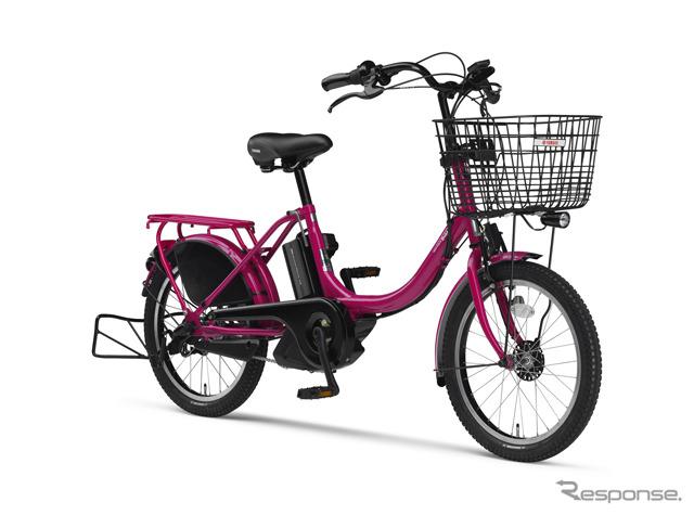 Dos niños a los estándares de pasajeros adaptaron Yamaha bicicletas asistidas por motor PAS peculiar modelo 2015