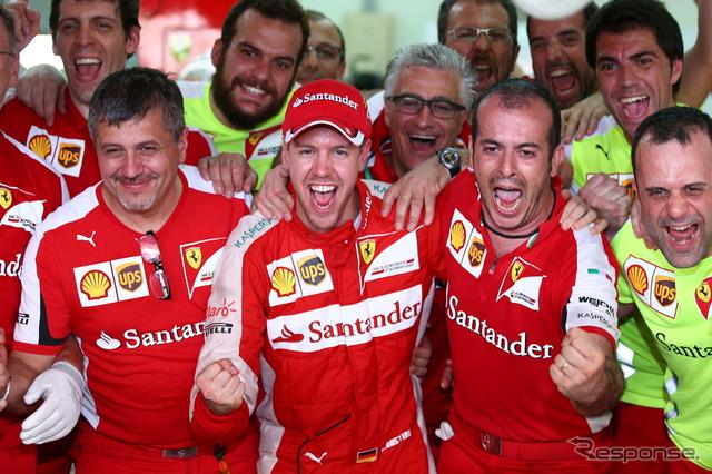 Sebastian Vettel celebrates victory with Ferrari staff