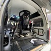 新型4軸モーション・レーシングシミュレーター開発、ハイエースに搭載した移動サービス開始