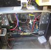 ペダルはない。右の小さい箱は回生ブレーキの制御ユニット。コンセントは情報機器の充電に使用。