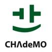 「Charge」を意味する回路記号と「Move」を意味する曲線で描かれたスマイルのロゴマーク