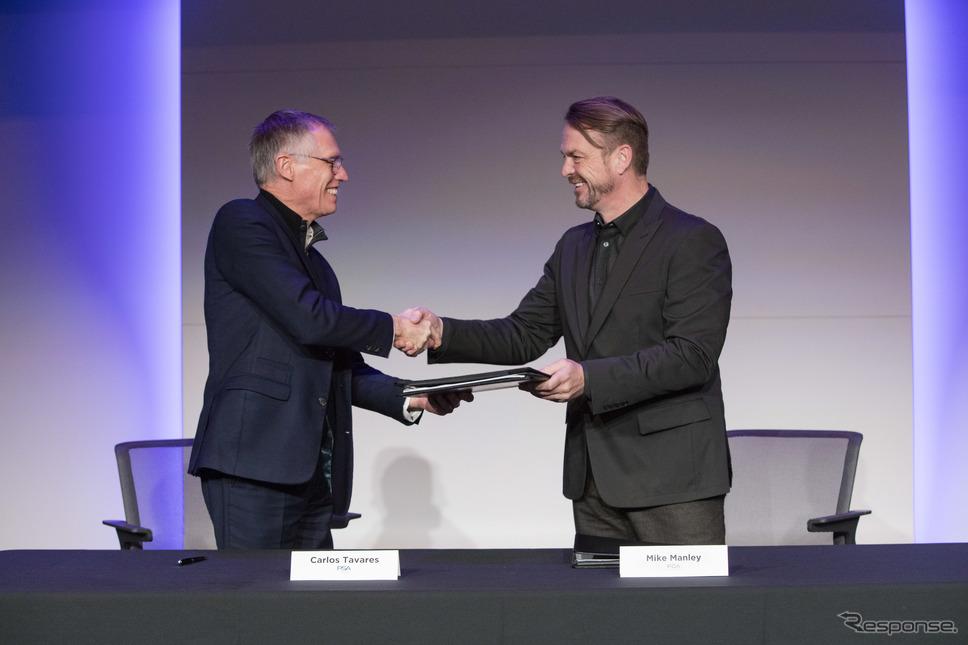 合併に合意する両社首脳(2019年12月)